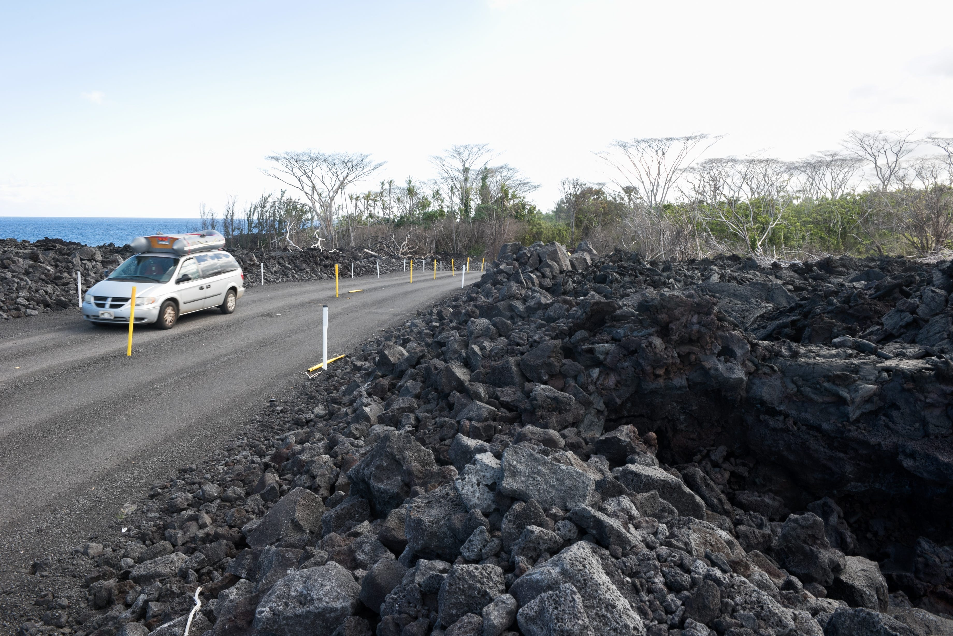 A temporary road was built over the lava field by the government to allow residents and tourists access to the newly formed black sand beaches in Puna, Hawaii.