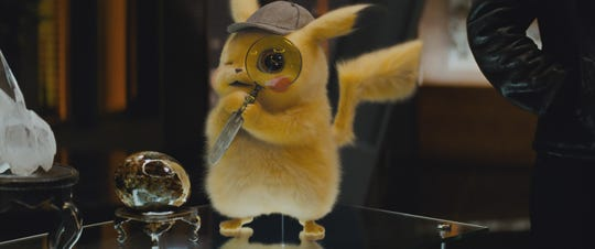 """Ryan Reynolds gives sassy life to the adorable title gumshoe of """"Pokemon: Detective Pikachu."""""""