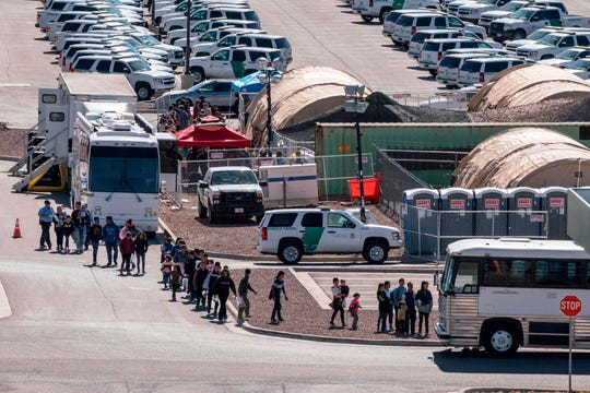 Migrants board buses to take them to shelters after being released from detention by Customs and Border Protection in El Paso, Texas, on April 28, 2019.