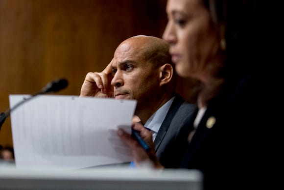 Democratic presidential candidates Sen. Cory Booker and Sen. Kamala H appear as Attorney General William Barr testifies during a Senate Judiciary Committee hearing on Capitol Hill in Washington, Wednesday, May 1, 2019.