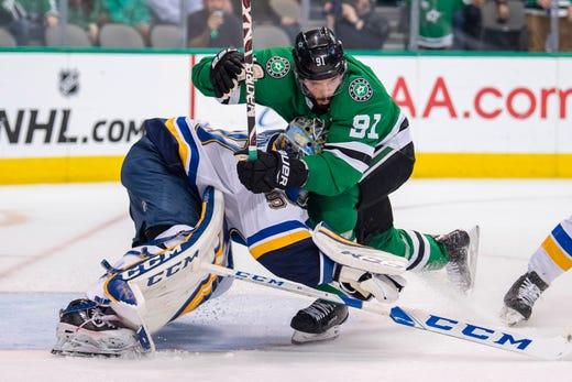 Second round: Dallas Stars center Tyler Seguin crashes into St. Louis Blues goaltender Jordan Binnington during the second period of Game 4.