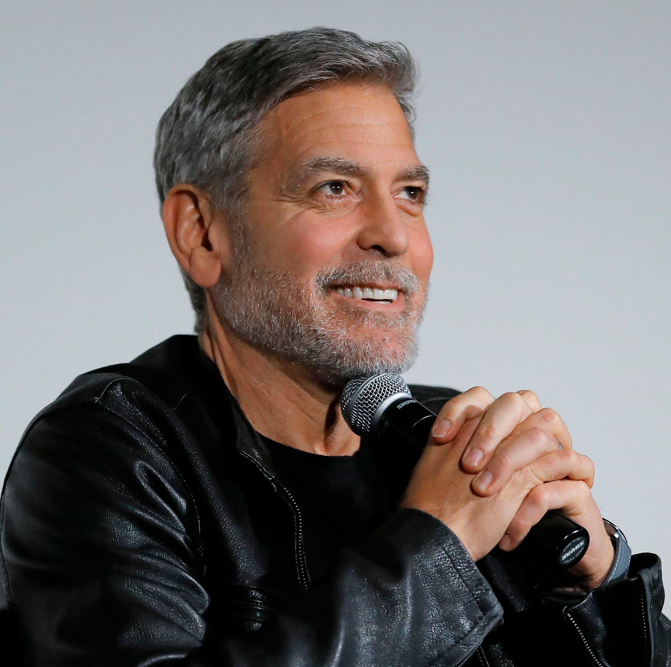 """George Clooney speaks onstage during Hulu's """"Catch-22"""" New York Special Screening at DGA Theatre on May 01, 2019 in New York City."""