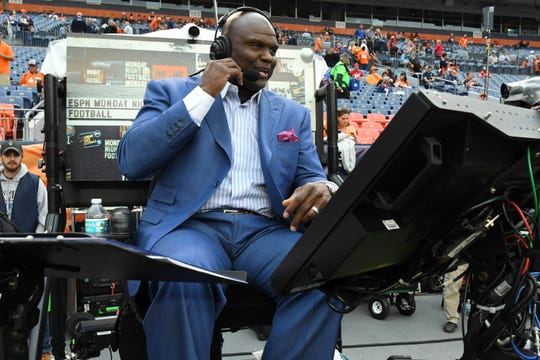 ESPN sideline analyst Booger McFarland looks on before a game between the Kansas City Chiefs against the Denver Broncos at Broncos Stadium at Mile High.
