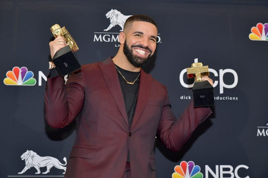 Drake poses with the awards for Top Artist, Top Male Artist, Top Billboard 200 Album for Scorpion,  in the press room during the 2019 Billboard Music Awards at MGM Grand Garden Arena on May 01, 2019 in Las Vegas, Nevada.