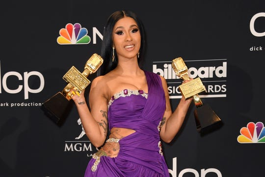Cardi B poses with the awards for Top Rap Song 'I Like It,' Top Hot 100 Song for 'Girls Like You,' in the press room during the 2019 Billboard Music Awards at MGM Grand Garden Arena on May 01, 2019 in Las Vegas, Nevada.