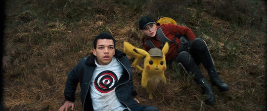 """Tim (Justice Smith, left), Pikachu (voiced by Ryan Reynolds) and Lucy (Kathryn Newton) are on the case in """"Pokemon: Detective Pikachu."""""""