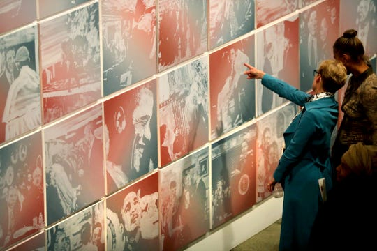 """People attend the opening of a new exhibit entitled """"The Obama Paintings,"""" at Stony Island Arts Bank on Chicago's South side on April<TH>18. The work consists of 2,922 portraits of President Barack Obama, one from each day of his presidency."""