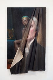 """In Titus Kaphar's """"Behind the Myth of Benevolence,"""" an iconic portrait of Thomas Jefferson is being peeled away from the canvas to reveal a portrait of an enslaved black woman."""