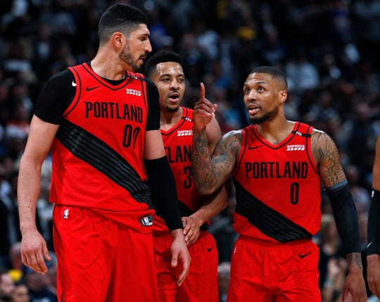 The Trail Blazers are making waves with center Enes Kanter (left) and guards CJ McCollum (center) and Damian Lillard.