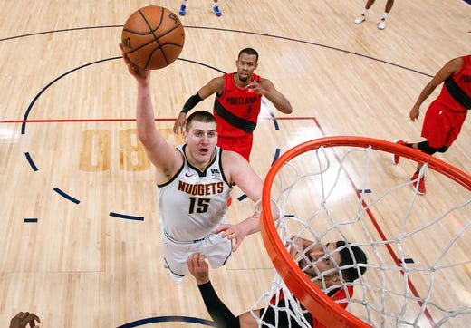 May 1: Nuggets center Nikola Jokic (15) drives to the bucket during Game 2 against the Blazers.