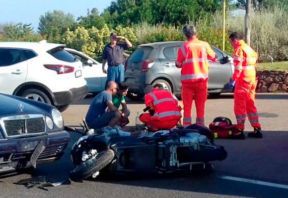 Ambulance personnel tend to George Clooney after being involved in a scooter accident on the Sardinia island, Italy on July 10, 2018.