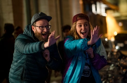 """Fred (Seth Rogen) and Charlotte (Charlize Theron) are in search of a high on the streets of France in the romantic comedy """"Long Shot."""""""