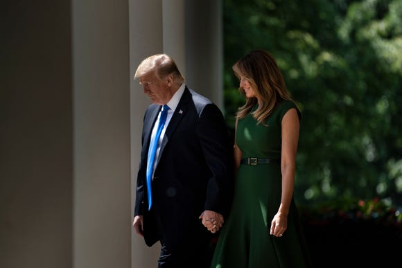 Donald Trump and Melania Trump arrive to celebrate the National Day of Prayer Service, in the Rose Garden of the White House in Washington, DC, on May 2,2019