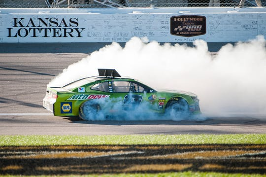 Chase Elliott performs a burnout after winning the 2018 playoff race at Kansas Speedway.