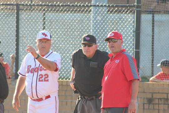 Managers Steve Williams (left) and Joey Golinski (right) talk with the manager before the game.