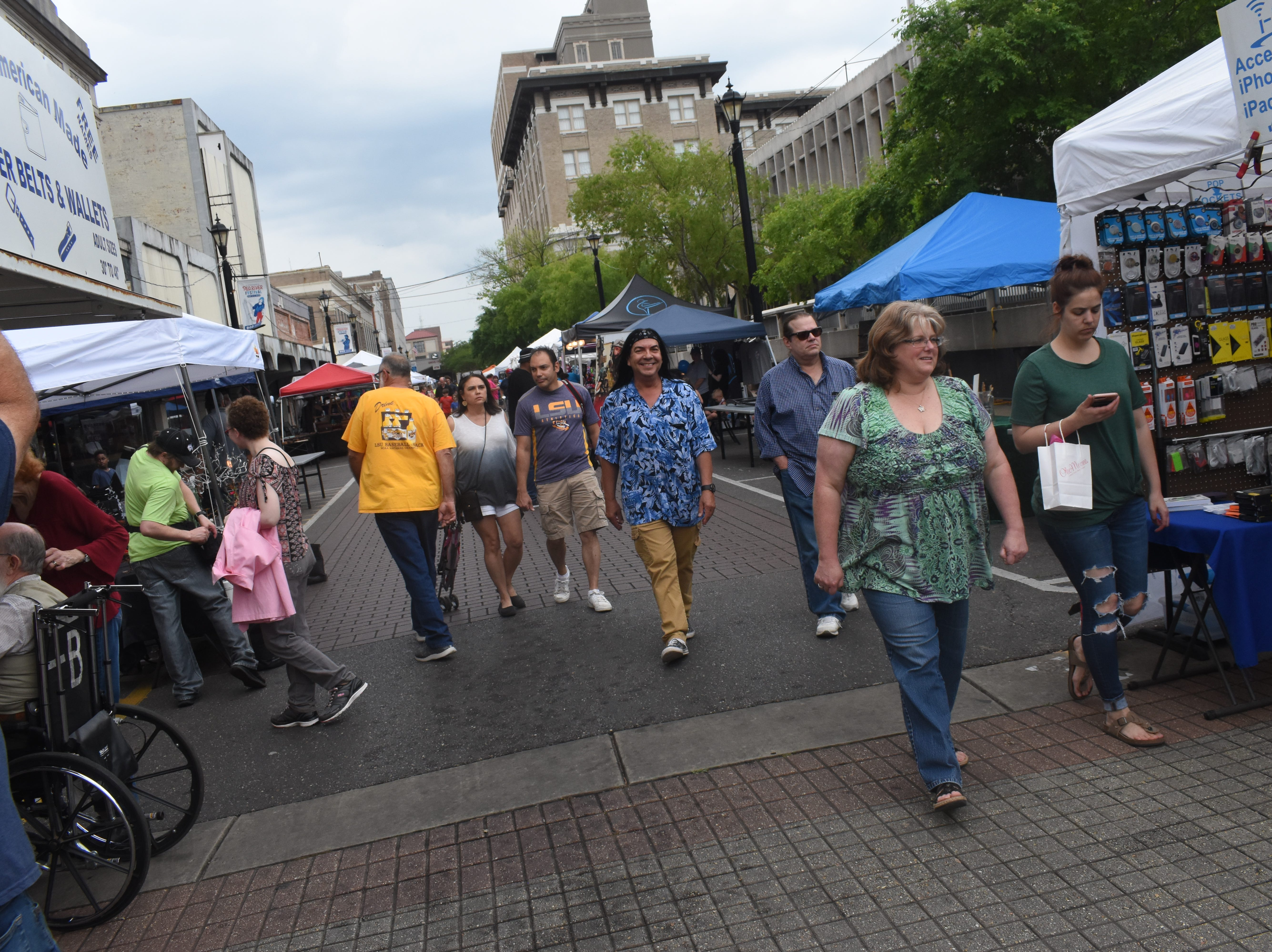 The Alexandria Red River Festival kicked off Friday, May 3, 2019 in downtown Alexandria with vendors, street performers and live music. The event continues Saturday along with with a bbq cookoff, classic car and truck show. The Louisiana Dragon Boat Races will be held at Lake Buhlow in Pineville starting at 9 a.m.