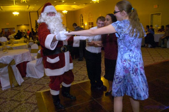 Santa Claus dances with students from St. Mary's Residential Training School during a Christmas party in 2013.