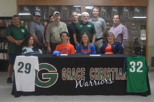 Grace Christian soccer players Matthew Delrie (bottom, second left) and Madi McDowell signed with Louisiana College Monday.