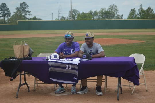 University Academy baseball players Darius Lavalais (left) and Jaylen Walker signed with Wiley College Tuesday.