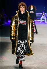 A model sports cow-print pants at Sao Paulo Fashion Week last month in Brazil.