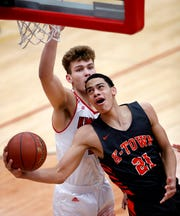 Kaukauna's Donovan Ivory goes for a layup against Kimberly during a game Dec. 7 in Kimberly.