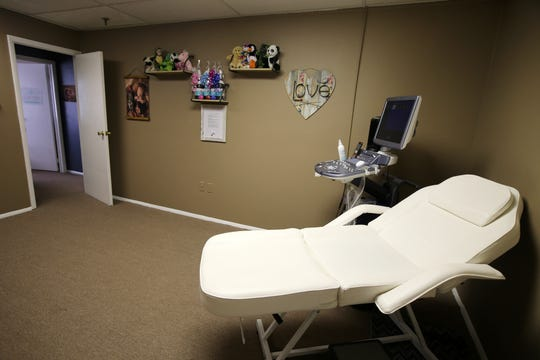 Mandy Figueroa, owner of Miraculous Moments, a year-old firm in Brick that specializes in pregnancy and provides 2D/3D/4D ultrasounds, holistic services, and education, tours the ultrasound room inside her business in Brick, NJ Friday, May 3, 2019.