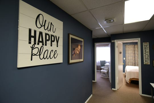 Mandy Figueroa, owner of Miraculous Moments, a year-old firm in Brick that specializes in pregnancy and provides 2D/3D/4D ultrasounds, holistic services, and education, tours the lobby inside her business in Brick, NJ Friday, May 3, 2019.