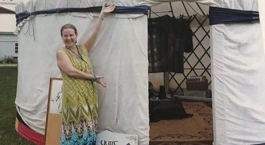 Kari Cooper of Hackettstown stands before one of her yurts.