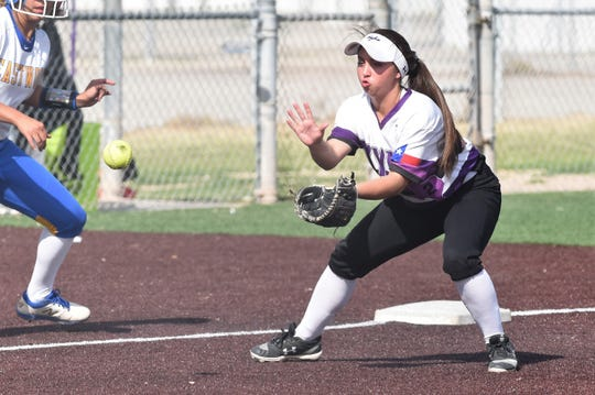 Wylie third baseman Madison Owen (2) looks in a ground ball during Game 1 of the Region I-5A area playoff against El Paso Eastwood in Pecos on Thursday, May 2, 2019. The Lady Bulldogs won 14-5 and 7-5 to reach the region quarterfinals.