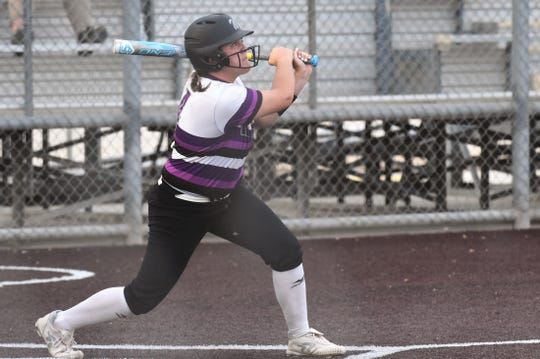 Wylie's Bailey Buck (4) follows through and watches her walk-off grand slam against El Paso Eastwood in Game 2 of the Region I-5A area playoffs in Pecos on Thursday, May 2, 2019. Buck's grand slam gave the Lady Bulldogs a 7-5 win and a series sweep.