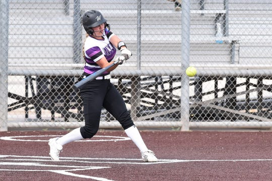 Wylie's Lilly New (16) delivers a three-run double during Game 1 of the Region I-5A area playoff series against El Paso Eastwood in Pecos on May 2. The Lady Bulldogs won 14-5 and completed the sweep with a 7-5 win in Game 2.