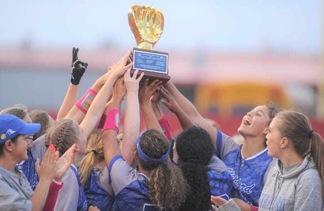 The Stamford softball team raises its area-playoff trophy after defeating Miles 8-1 on Thursday, May 2, 2019, in Hermleigh.