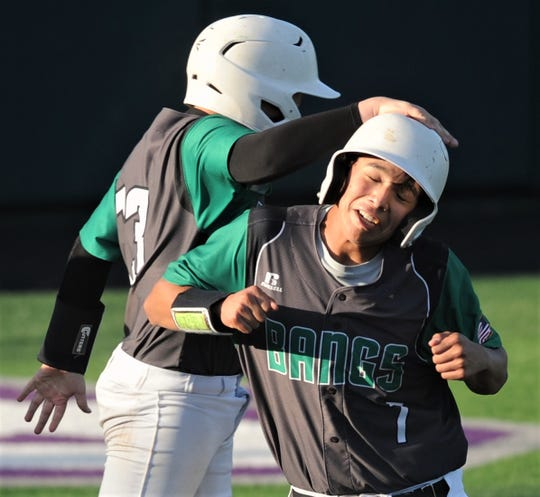 Bangs' Angel Arias (7) is congratulated by a teammate after scoring a run in the second inning. Clyde won the game 5-4 to sweep the best-of-three Region I-3A bi-district series Thursday, May 2, 2019, at ACU's Crutcher Scott Field.