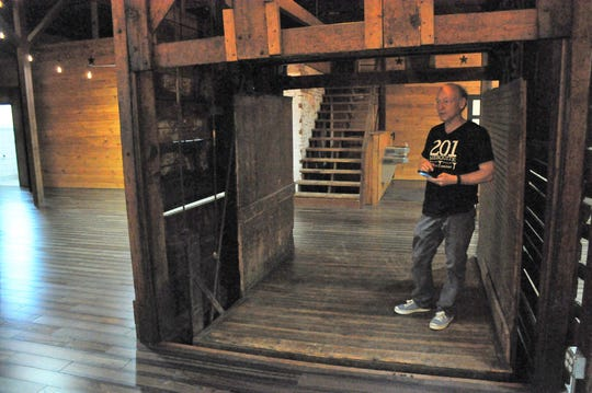 Charlie Wolfe, owner of 201 Mesquite Event Center, stands in the freight elevator located in one of the two rooms available for dances, weddings and other activities.