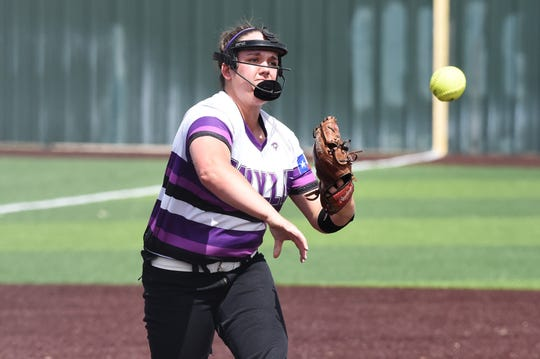 Wylie pitcher Bailey Buck (4) throws to first for an out during Game 1 of the Region I-5A area playoff series against El Paso Eastwood in Pecos on May 2, 2019. Buck will play next season at Cisco College.