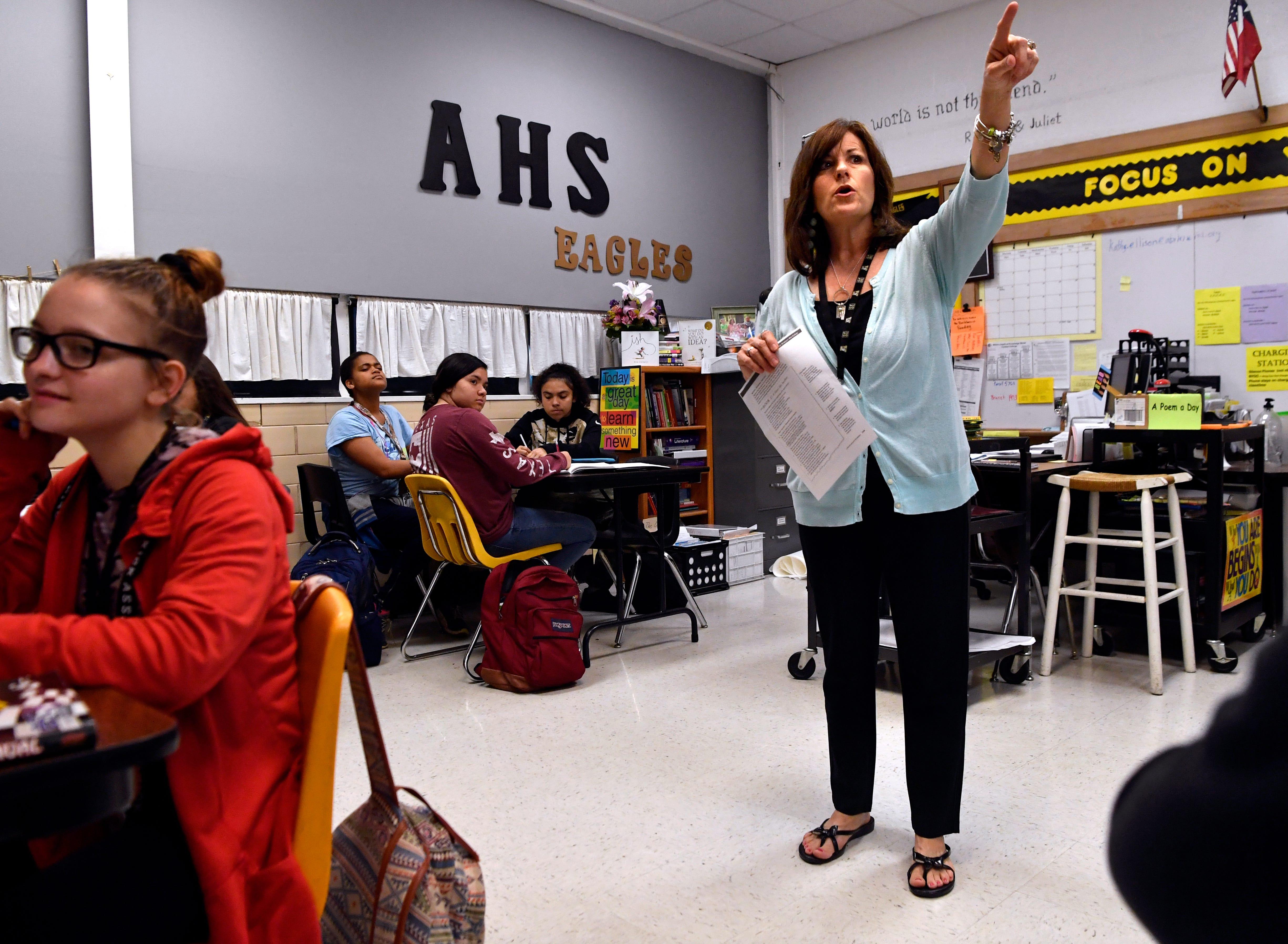 Kathy Ellison teaches an English class at Abilene High School.