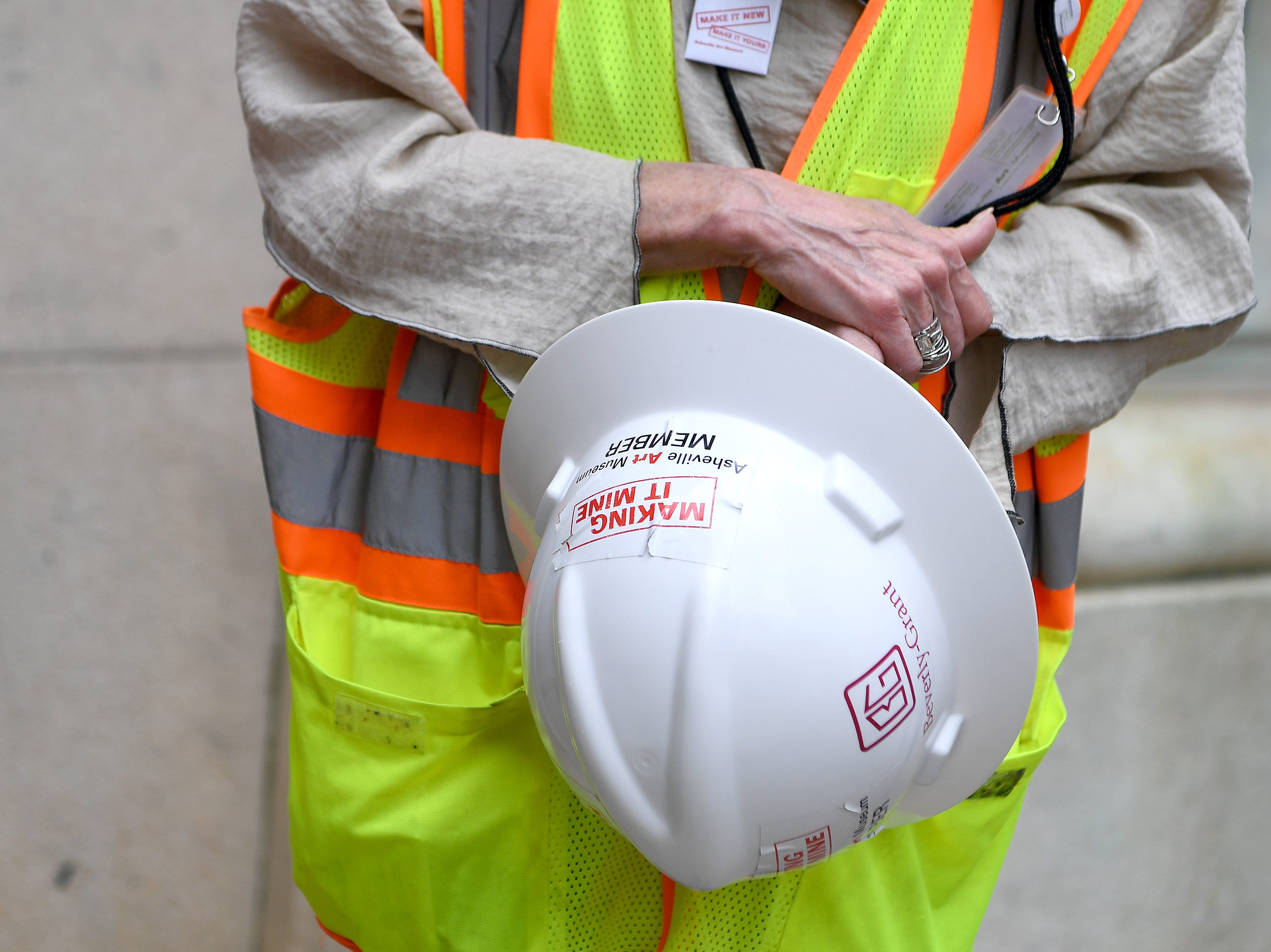 Asheville Art Museum executive director Pamela Myers holds her hard hat before a media tour on May 3, 2019 of the new museum where construction is being wrapped up for a summer opening.