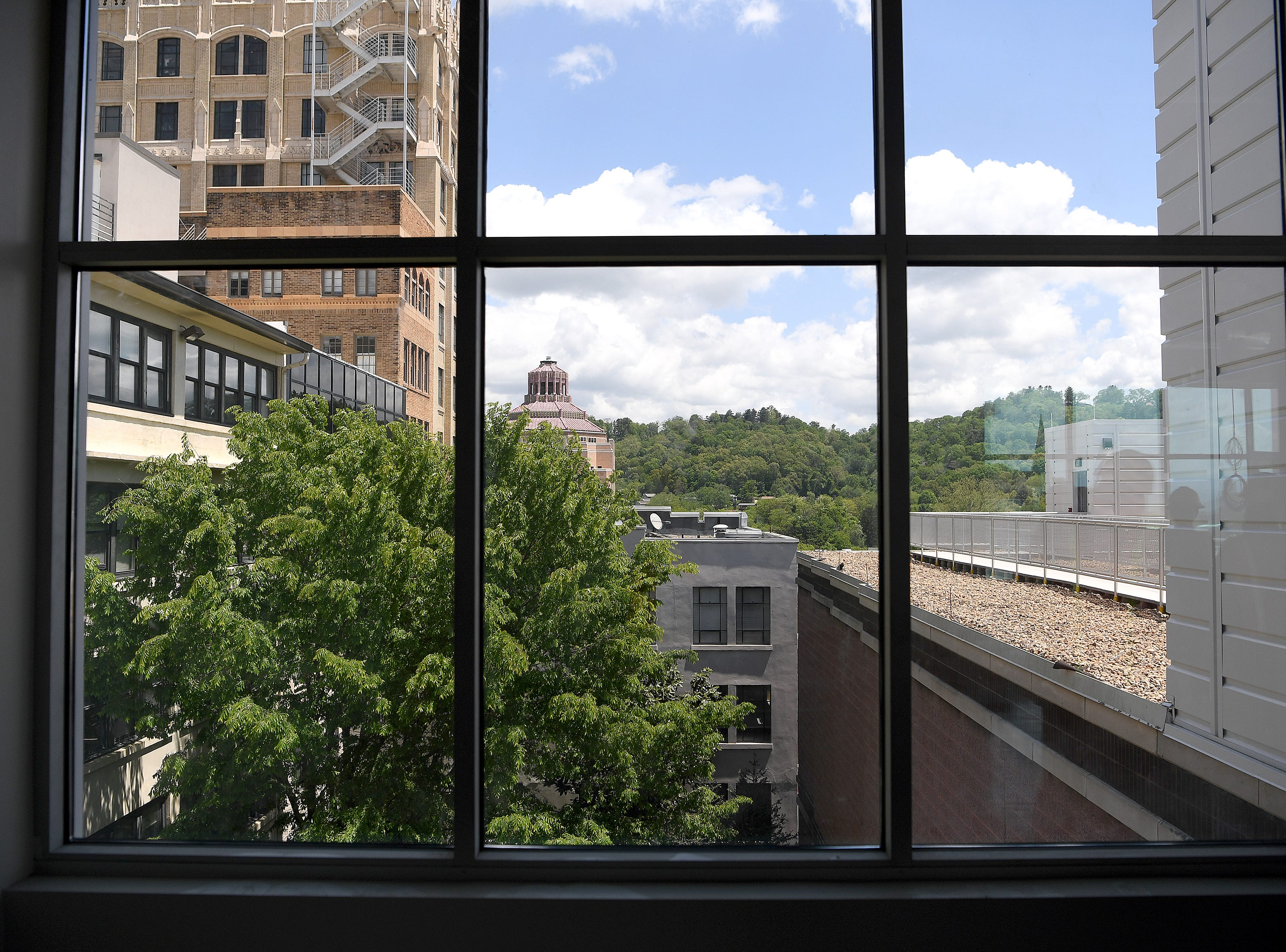 A new rooftop cafe will be opening during museum hours at the Asheville Art Museum when the building opens this summer.