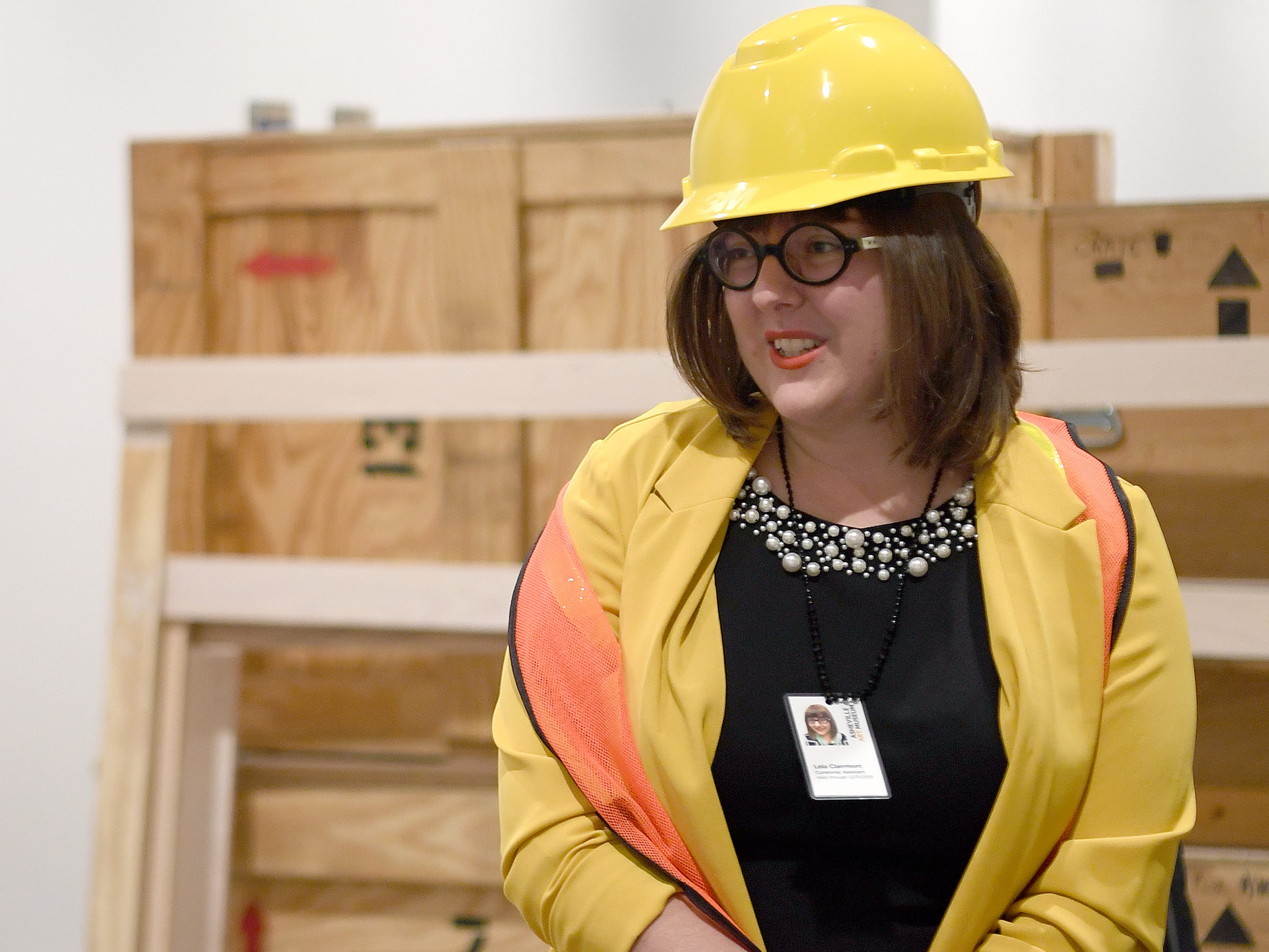 """Asheville Art Museum curatorial assistant Lola Clairmont talks about the coming exhibit, """"Appalachia Now! An Interdisciplinary Survey of Contemporary Art in Southern Appalachia"""" during a media tour of the new museum on May 3, 2019."""
