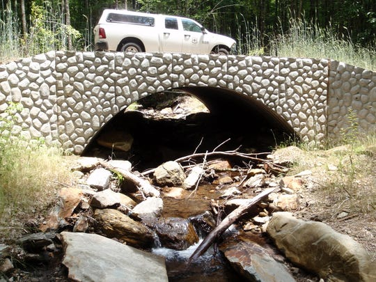 This renovated stone arch over Buck Creek shows the type of watershed improvements the Forest Service plans in the Buck Project.