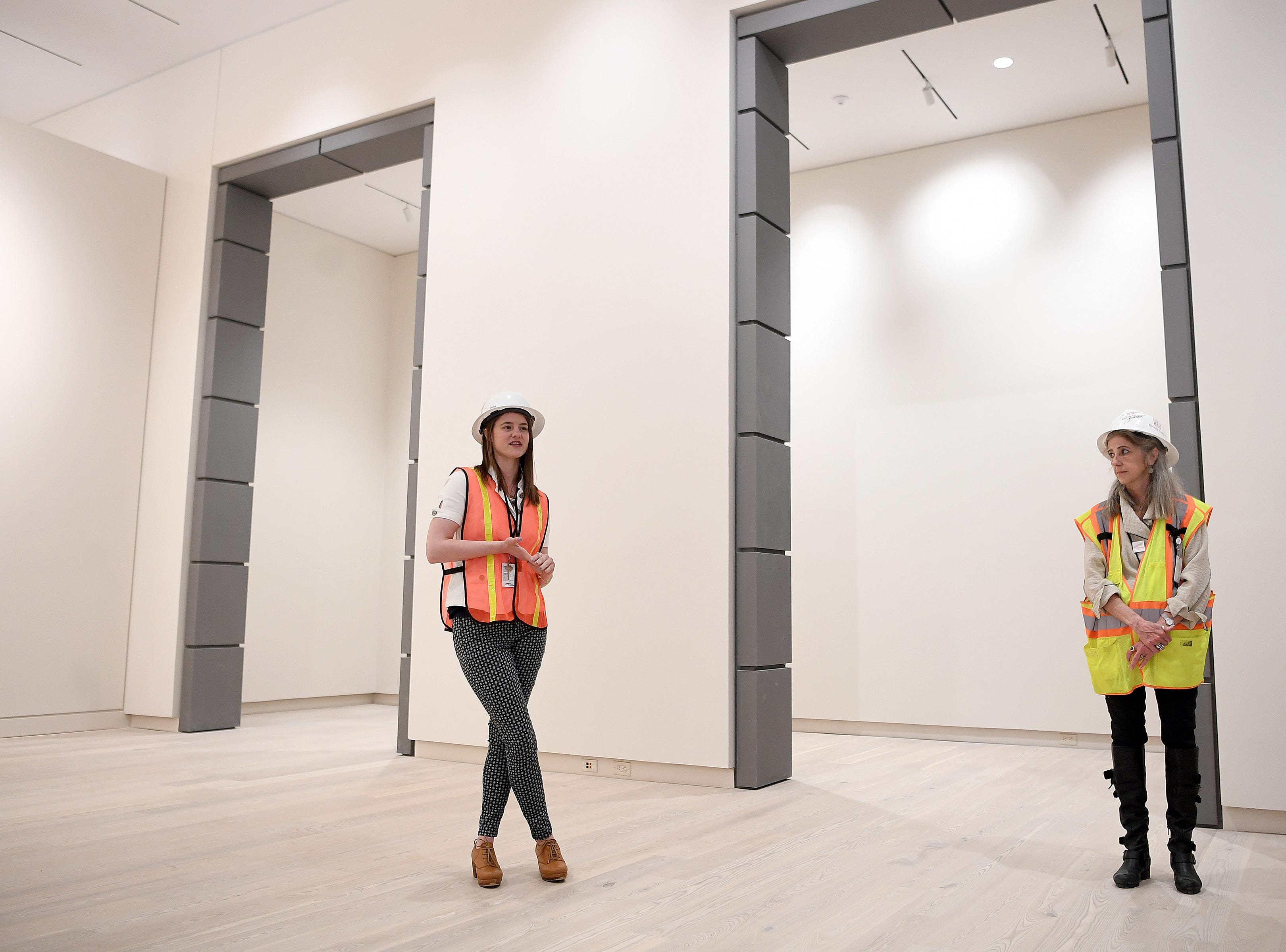Asheville Art Museum curatorial assistant Hilary Schroeder talks about the exhibit which will be displayed once the construction is complete during a media tour of the new building on May 3, 2019.