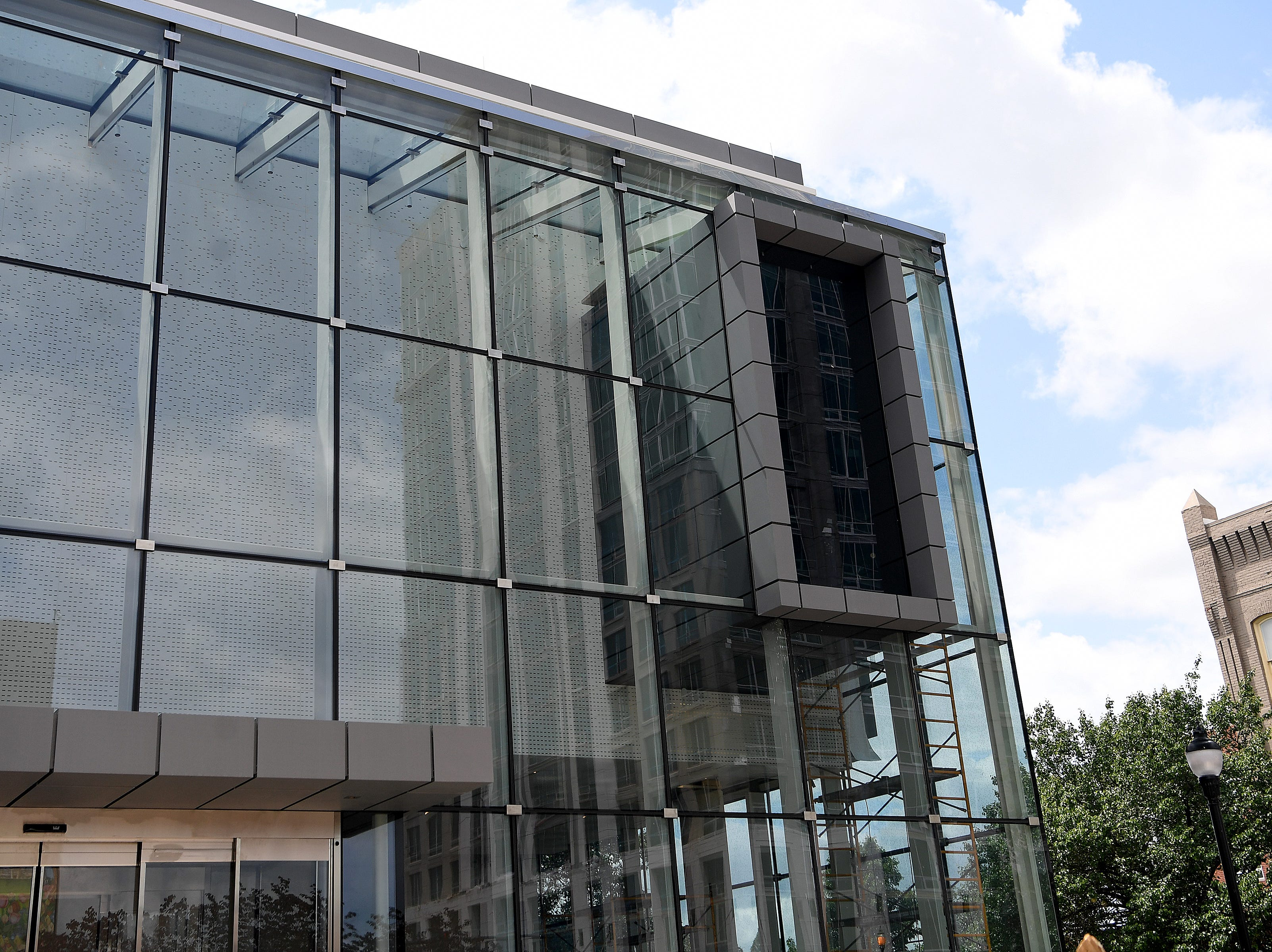 The front of the new Asheville Art Museum features a randomized perforated pattern that glows at night.  Construction is wrapping up in the museum which is part renovation, part historic preservation of the 1926 Pack Library building and part new construction.
