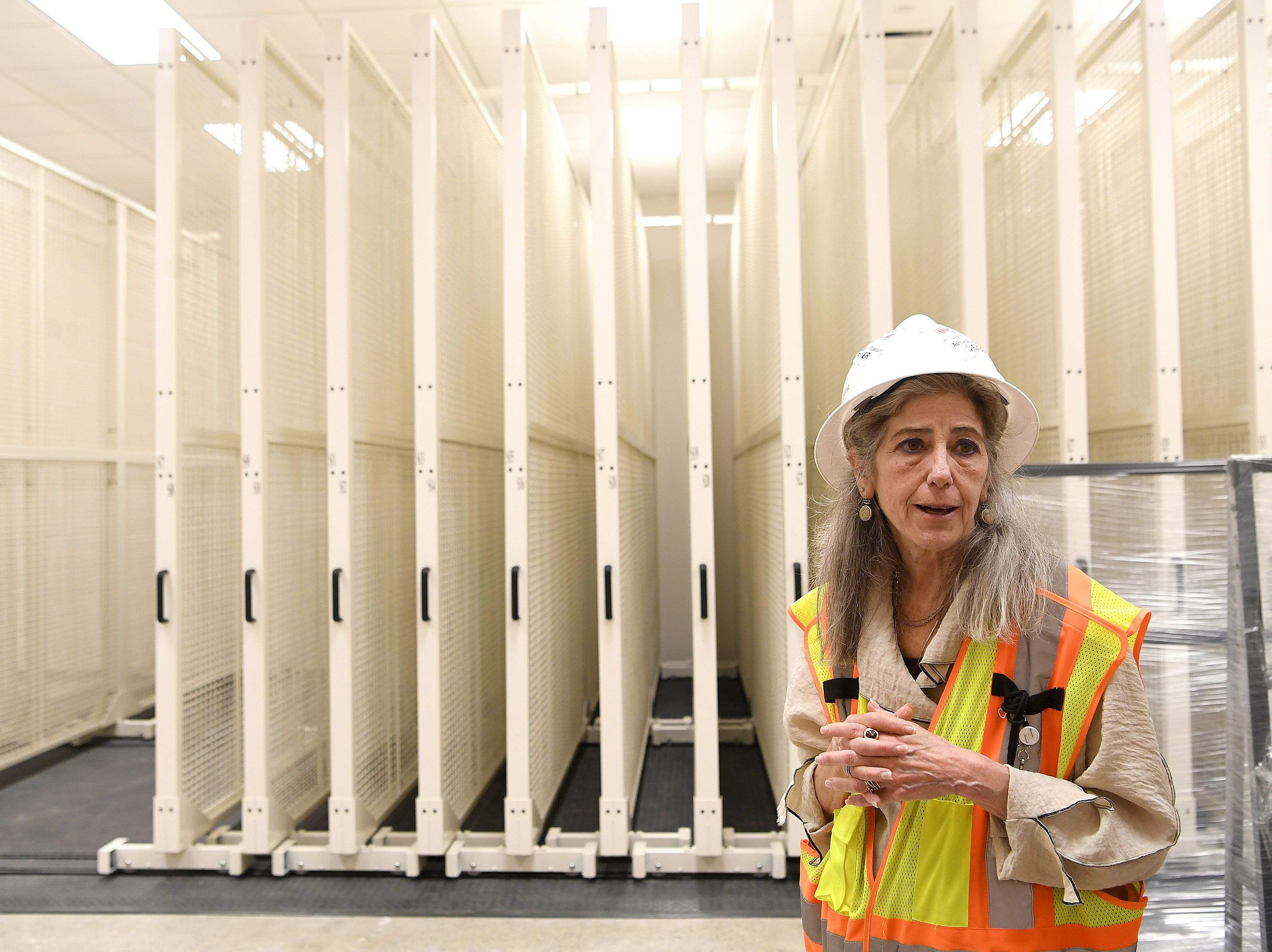 Asheville Art Museum executive director Pamela Myers talks about the art storage area during a media tour on May 3, 2019 of the new museum where construction is being wrapped up for a summer opening.