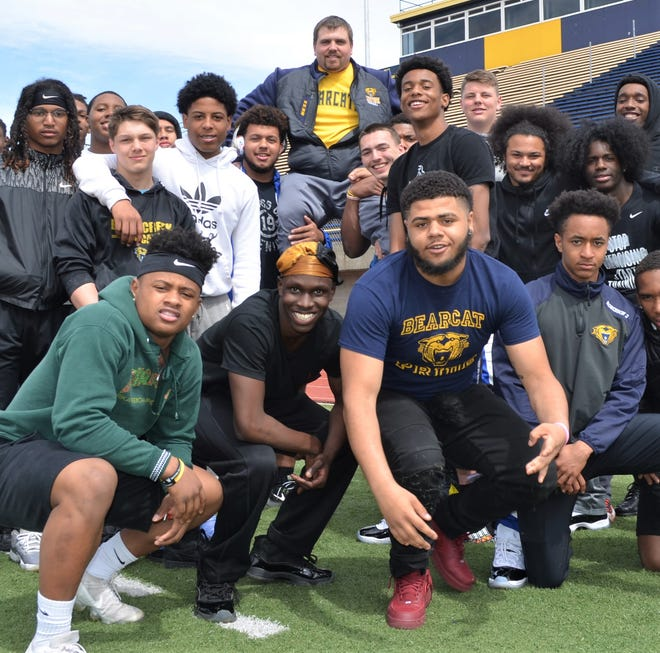 In winning this year's George Award, Battle Creek Central coach Casey Bess has lifted up many of his players with his 'Tuesdays With Coach Bess' initiative. Here, his players return the favor by lifting him up.