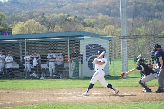 Susquehanna Valley's Dan Matthews follows through on a sacrifice fly he hit in the first inning of Thursday's game against visiting Windsor. SV won, 5-1.