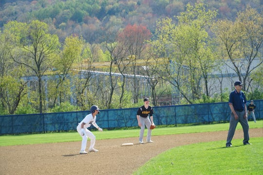 Windsor second baseman Dylan Cappello tries to keep an SV runner close in the first inning of Thursday's game at SV. The Sabers won, 5-1.