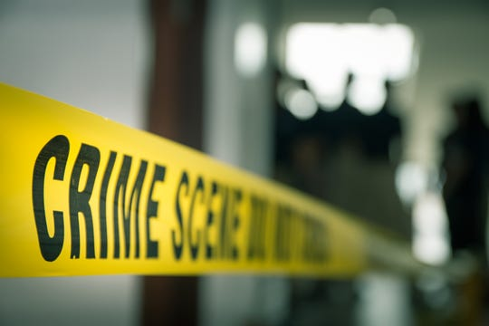 Crime concept by police line tape