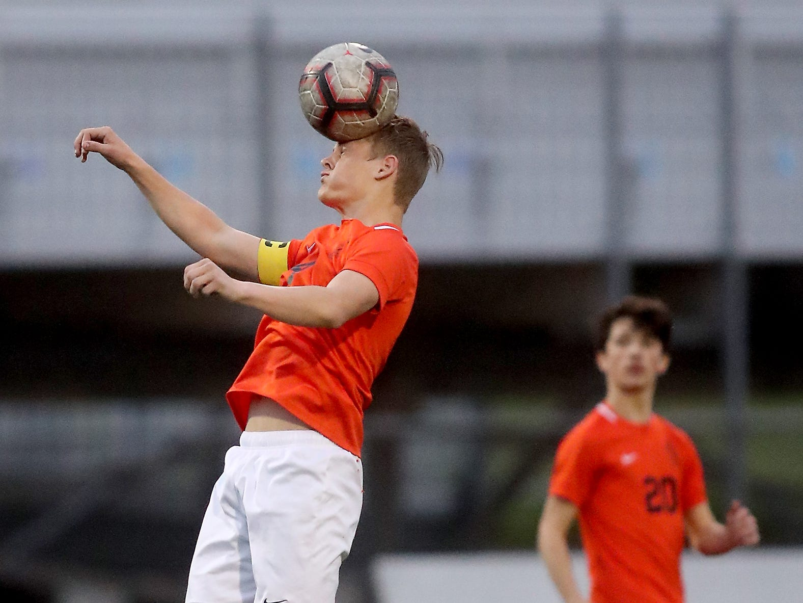 Central Kitsap's Carter Nilsen heads the ball against North Thurston at Silverdale Stadium on Thursday, May 2, 2019.
