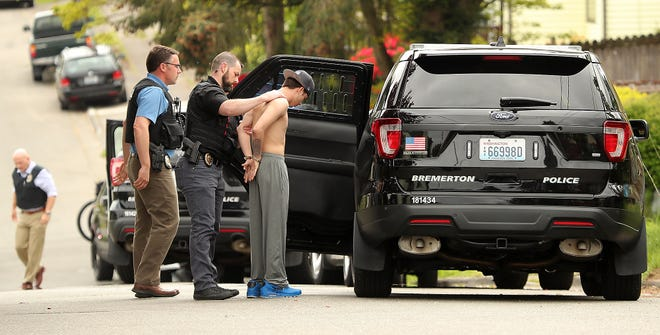 A suspect in a March robbery in which a victim was tied up and made to withdraw money from his bank account at an ATM is apprehended by Bremerton Police in the vicinity of 1300 Marguerite Avenue on Thursday, May 2, 2019.