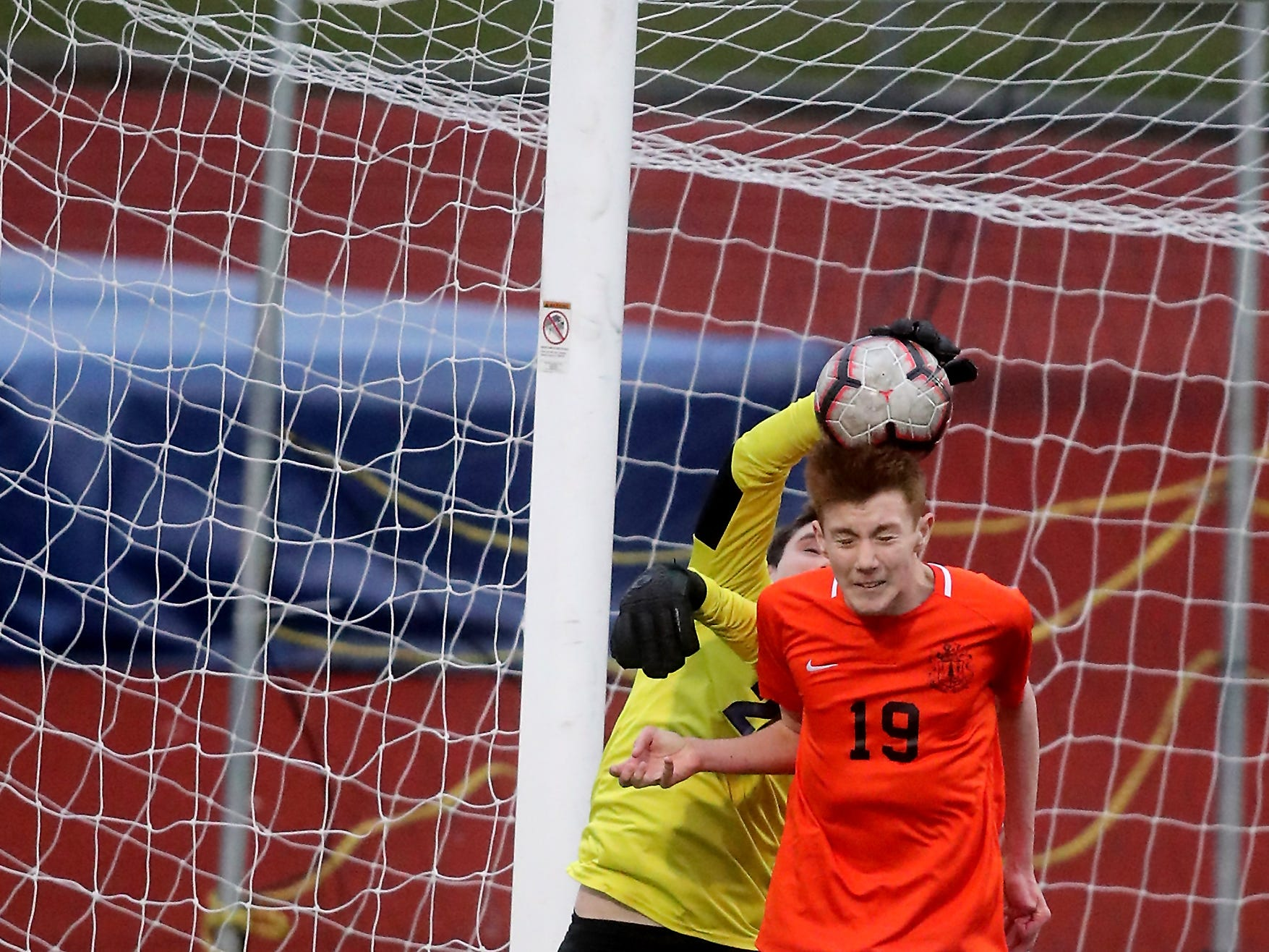 North Thurston goalie Zachary Mayer gets his hand on a header by Central Kitsap's Garret Ruth (19) during their game at Silverdale Stadium on Thursday, May 2, 2019.